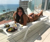 happy girl in bikini on hotel balcony